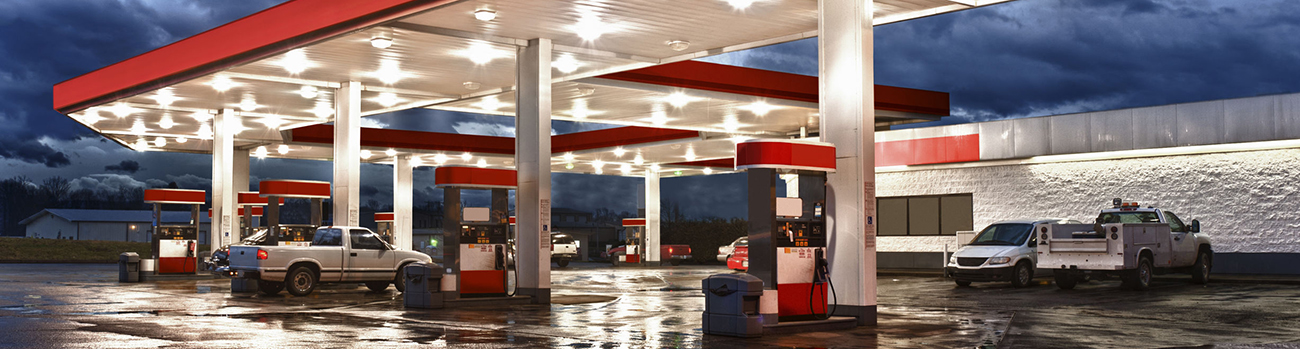 33808830 - gasoline station convenience store/high dynamic range photograph/  all identifying logos and trademarks have been removed, and station?s original color scheme has been replaced.