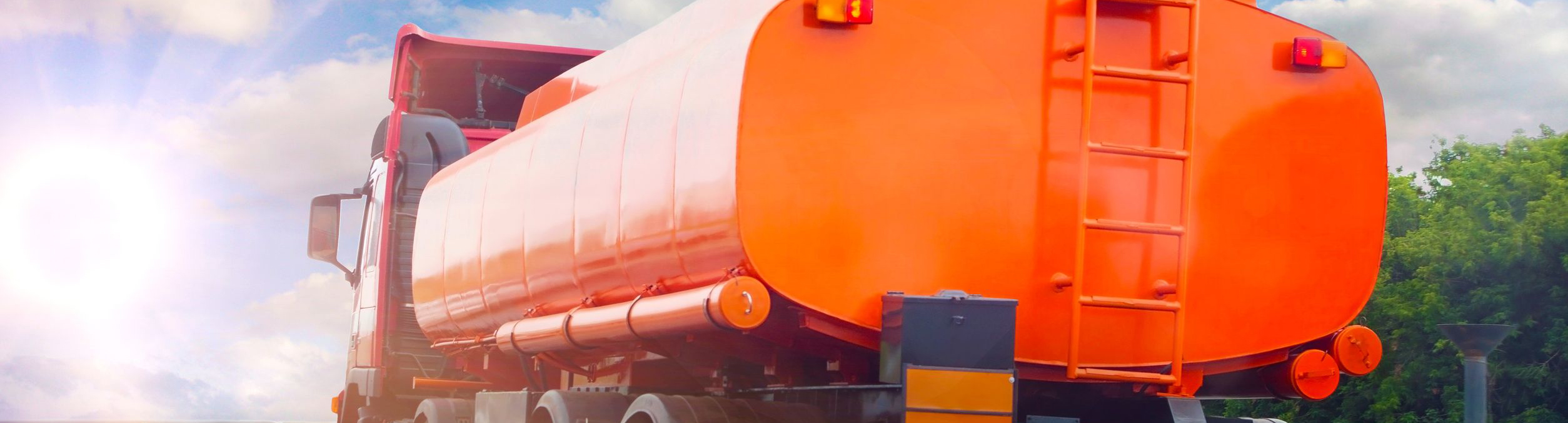 15462723 - big gas-tank truck goes on highway against the sky